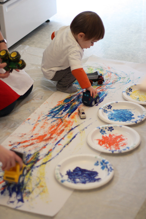 Tire Track Painting: use toy cars to create tire track prints on paper.