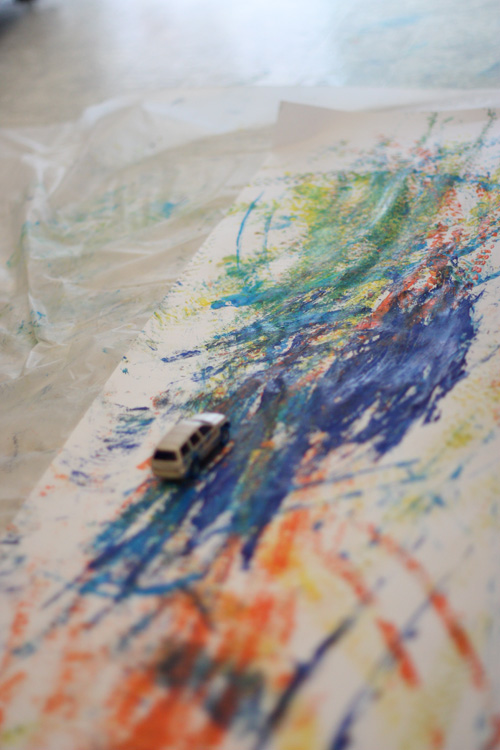 Tire Track Painting: make a fun abstract painting using toy cars instead of paintbrushes!